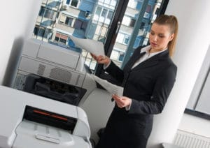 business woman at office printer